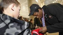 In this file photo, Team Canada gold medal winning junior hockey player Wayne Simmonds, of Pickering, Ont., (right) signs autographs as he arrives home at Pearson International Airport in Toronto, Sunday, January 6, 2008. The Philadelphia Flyers, right-winger was the target of racial abuse during a Czech League game on Sunday. (J.P. Moczulski/The Canadian Press)