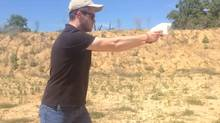 Screengrab of Cody Wilson hand-firing the Liberator, a almost entirely plastic single shot hand gun printed on a 3D printer, the plans for which are now available online. (Andy Greenberg, Forbes/YouTube)