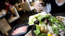 All you can eat sukiyaki platters of pork, beef, tofu and veggies seen here being cooked in a hot-pot at Posh restaurant September 24, 2007 in Richmond, B.C. (Rafal Gerszak/Rafal Gerszak/ The Globe and Mail)