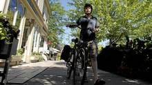 Globe and Mail Theatre critic Kelly Nestruck walks his bike down Queen Street in Niagara On The Lake. Photo By Sheryl Nadler (Sheryl Nadler For The Globe and Mail/Sheryl Nadler For The Globe and Mail)