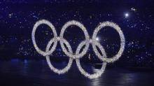 The Olympic rings are lit up with lights as they are raised up by a sheer curtain at the opening ceremony for the 2008 Beijing Olympics. (Fred Lum/The Globe and Mail)