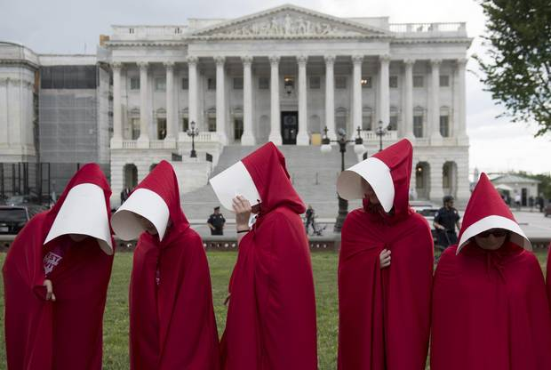 Supporters of Planned Parenthood dressed as characters from The Handmaid's Tale hold a rally as they protest the U.S. Senate Republicans' healthcare bill outside the U.S. Capitol on June 27, 2017.