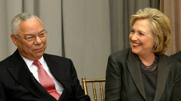 Former U.S. Secretaries of State Colin Powell and Hillary Clinton are shown on Sept. 3, 2014.
