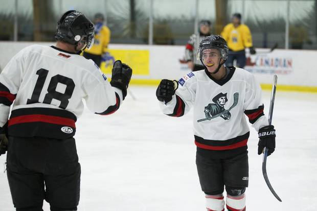 Justin Connelly, right, celebrates his goal with team captain Michael Bell.
