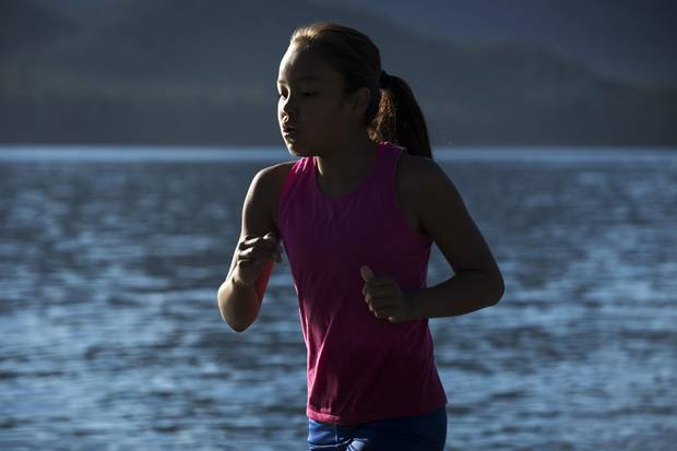 Samara Swan, 11, runs through the Pacific Ocean to train for tack and field on the beach near her home, in Ahousaht, on Flores Island in Clayoquot Sound.
