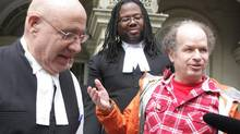 Israeli national Dror Bar-Natan, right, is seen with his lawyers Peter Rosenthal (left) and Selwyn Pieters outside the Ontario Court of Appeal in Toronto on Tuesday, April 8, 2014. Bar-Natan is one of three permanent residents challenging the constitutionality of requiring an oath to the Queen as a condition of Canadian citizenship. (Colin Perkel/THE CANADIAN PRESS)
