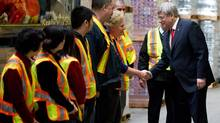 Prime Minister Stephen Harper meets Canadian Fishing Company employees during a photo opportunity at a warehouse in Richmond, B.C., on March 12, 2014. (DARRYL DYCK/THE CANADIAN PRESS)