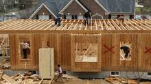 File photo of workers building a new house in Alexandria. (KEVIN LAMARQUE/REUTERS)
