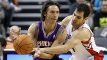 Toronto Raptors guard Jose Calderon tries to strip the ball away from Phoenix Suns guard Steve Nash during the first half of their NBA preseason basketball game in Toronto October 17, 2010. (Reuters)