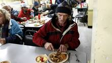 Edward Czarnecti, eating his lunch at The Good Neighbors Club in Toronto on Oct. 26, 2011, is one of the 300 people who are given daily meals at the agency that receives funds from the United Way. (Fernando Morales/Fernando Morales/The Globe and Mail)