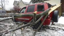 A damaged truck is shown in Toronto on Dec. 22, 2013, after part of a tree crashed onto it during an ice storm. (Fred Lum/The Globe and Mail)