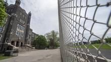 Exterior photos of Central Technical School (LEFT) and it's closed playing field in Toronto on May 21 2014. (Fred Lum/Fred Lum/The Globe and Mail)
