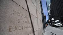 While the lettering has since been removed, the sign for the old Toronto Stock Exchange at 234 Bay St. can still be read on April 17 2014. The building is now home to the Design Exchange. (FRED LUM/THE GLOBE AND MAIL)