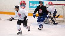 Former NHL star Doug Gilmour, centre, plays against media members Thursday in Toronto as part of the official kick-off to the 2013 Scotiabank Pro-Am for Alzheimer's tour