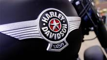 In this Jan. 20, 2012 photo, the Harley-Davidson logo is displayed on a new motorcycle for sale in the show room of Hall's Harley-Davidson Cycles, in Springfield, Ill. (Seth Perlman/SETH PERLMAN/AP)