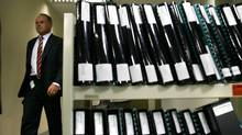 Then-Canadian Security Intelligence Service Assistant Director Jack Hooper walks past stacks of documents in 2005. He wrote a classified November 2005 memo that spells out the spy service's policy on unannounced workplace visits/ (Jim Young/Reuters/Jim Young/Reuters)