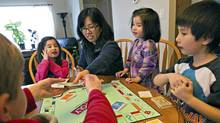Clark Hunter, Sarah Kirsop, Marjorie Kirsop, Leah Kirsop and Paul Kirsop play Monopoly together in their home in Morinville after arriving home from school at Notre Dame Elementary on Wednesday March 2, 2011. (Jason Franson Globe and Mail/Jason Franson Globe and Mail)