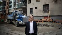 Rize CEO William Lin stands in front of his Rolston condo venture now under construction on Granville Street. (Rafal Gerszak For The Globe and Mail)