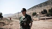 Thwaiba Hanafi, a Canadian citizen born in Syria, stands at the Turkish-Syrian border in Reyhanli, Turkey, on Thursday. Ms. Hanafi recently joined the Free Syrian Army and now acts as a co-ordinator of the Military Council of the FSA. (Daniel Etter for The Globe and Mail)