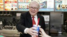 Warren Buffett hands out a Girl Scout Thin Mint Cookie Blizzard at a Dairy Queen in Omaha, Neb. (Nati Harnik/Nati Harnik/AP)