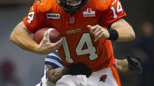 Travis Lulay of the B.C Lions runs the ball against the Toronto Argonauts during the second half of their CFL football game in Vancouver, British Columbia, September 15, 2012. (BEN NELMS/REUTERS)