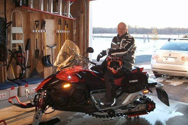WO Florian on his snowmobile in April, 2007, at his home in Harrowsmith, Ont.