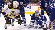 Toronto Maple Leafs goalie Jonas Gustavsson looks at the puck in the net after Boston Bruins' Jordan Caron lifted it past him in the first period. (FRED THORNHILL/Fred Thornhill/Reuters)