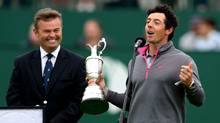 Rory McIlroy of Northern Ireland speaks while holding the Claret Jug trophy after winning the British Open Golf championship at the Royal Liverpool golf club, Hoylake, England, Sunday July 20, 2014. (Scott Heppell/AP Photo)