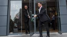 Police investigators leave the offices of the McGill University Health Centre (MUHC) in Montreal, Tuesday, September 18, 2012. (Graham Hughes/Canadian Press)