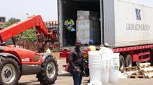 Workers from Doctors Without Borders unload emergency medical supplies to deal with an Ebola outbreak in Conakry, Guinea, March 23, 2014. (Reuters)