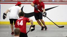 In lieu of putting on skates and playing on ice, the Canadian players invited to Olympic orientation camp played ball hockey. (Jeff McIntosh/The Canadian Press)