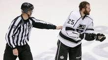 Los Angeles Kings left wing Dustin Penner (25) is escorted off the ice after a penalty during the third period of Game 2 of the NHL hockey Stanley Cup Western Conference finals against the Phoenix Coyotes, Tuesday, May 15, 2012, in Glendale, Ariz. (Matt York/Associated P