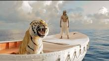 Suraj Sharma and Bengal tiger in Life of Pi.