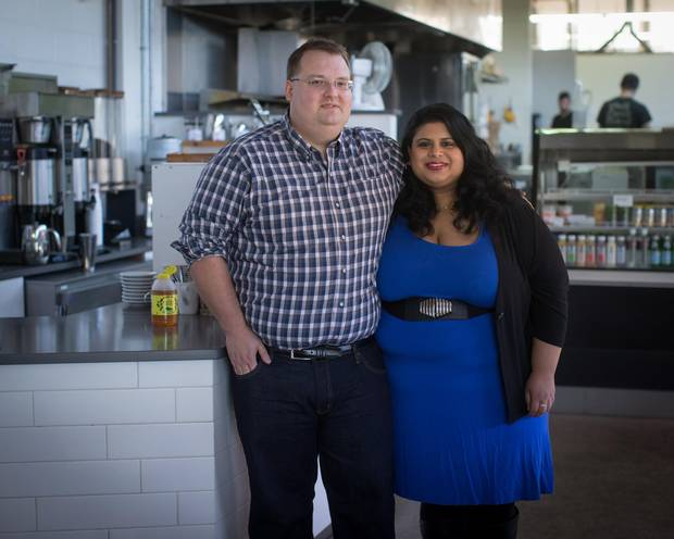 Jeff Salzsauler and Michelle Pinto are shown at an outlet of Vancouver's JJ Bean Coffee Roasters, where Mr. Salzsauler works as a product developer. 'If we were still living in Winnipeg, we would be an upper-class family,' Mr. Salzsauler says. 'But in Vancouver, we are very solidly middle-class.'