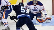 Winnipeg Jets' Mark Scheifele skates in to shoot on Edmonton Oilers goalie Richard Bachman (Trevor Hagan/The Canadian Press)