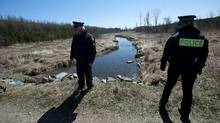 OPP officers are seen at a small creek near the site where Tori Stafford's body was found near Mount Forest, Ont. Monday, April 2/2012. The jury in the Michael Rafferty trial were given a tour of the site after which the media were allowed to have access. (Kevin Van Paassen/Kevin Van Paassen/The Globe and Mail)