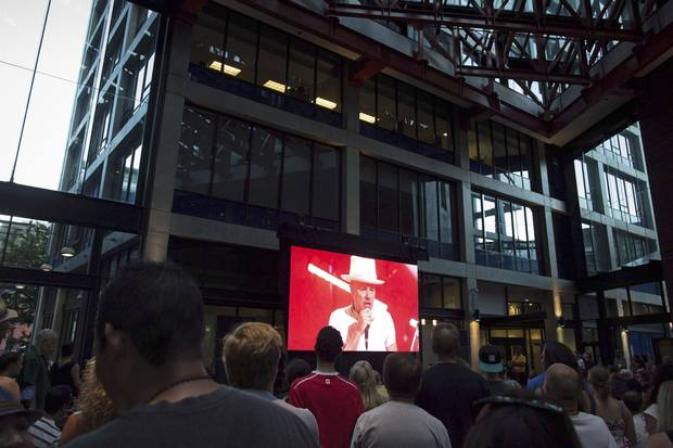 Fans in Vancouver gather at a viewing party for the final Tragically Hip show in Kingston.