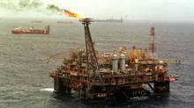 Natural gas burns off at the Petrobras Palataforma 26, about 100 nautical miles from the Brazilian coastline in the Campos Basin of the Atlantic Ocean, in this 1999 file photo. Airports in Campos and Cabo Frio, Brazil, key bases in Rio de Janeiro state for helicopter service to offshore oil platforms in the Campos Basin, were blockaded for up to six hours on Thursday in an intensifying dispute over royalties, preventing oil workers from boarding flights to drilling rigs and production platforms. (DOUGLAS ENGLE/ASSOCIATED PRESS)
