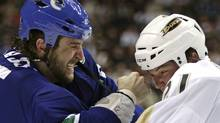 "''I think everyone understands the risks involved with fighting, just like a boxer or an MMA guy, '' says Winnipeg Jets forward Tanner Glass, who according to www.hockeyfights.com has taken 33 fighting majors in four NHL seasons, including 15 in 2009-10. ''There are risks involved just like anything else."" Glass, left, then with the Vancouver Canucks, and Anaheim Ducks' Sheldon Brookbank fight during the first period of an NHL hockey game in Vancouver on Wednesday March 24, 2010. THE CANADIAN PRESS/Darryl Dyck (Darryl Dyck)"