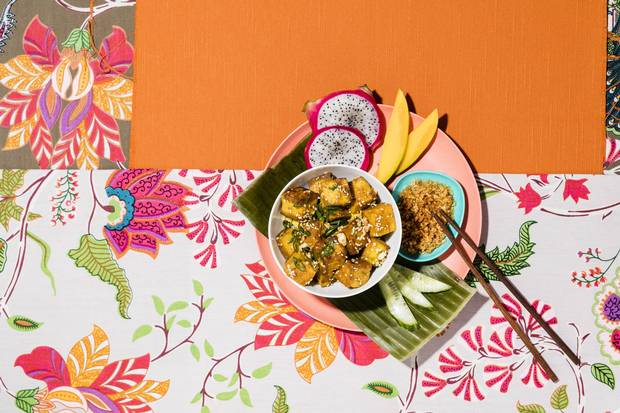 Floral bedspread (used as tablecloth), $75 at Morningstar Trading Co. Ltd. Chopsticks and melamine dish, stylist's own.