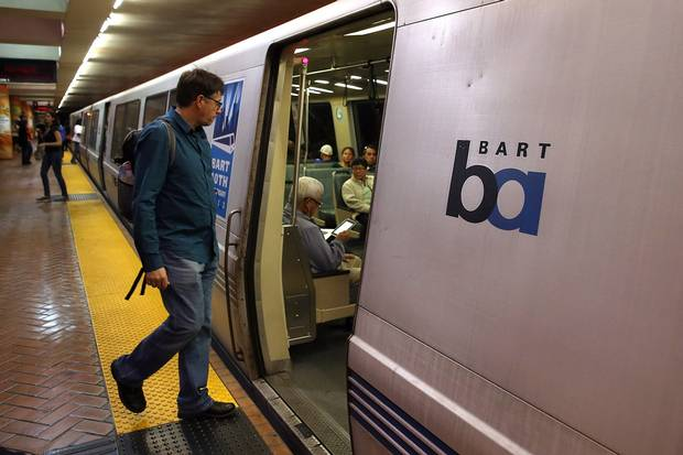 A Bay Area Rapid Transit (BART) passenger boards a train on Oct. 15, 2013, in San Francisco. The transit agency is experimenting with reducing the number of seats on some trains.