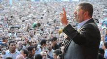 Egypt's President Mohammed Morsi speaks to supporters in front of the presidential palace in Cairo November 23, 2012. (Egyptian Presidency/Handout/Reuters)