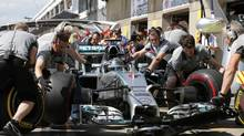 Mercedes driver Nico Rosberg of Germany practices a pit stop during the second free practice of the Canadian F1 Grand Prix at the Circuit Gilles Villeneuve in Montreal June 6. (CHRIS WATTIE/REUTERS)