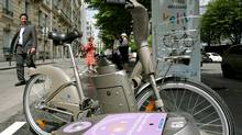 "A new self-service bicycle called Velib (""free bike"" in French) is seen in Paris June 13, 2007. By July 15, the city plans to park 10,648 bicycles at 750 stations and nearly double that by 2008, with riders able to take bikes from one station and drop them off at another. (BENOIT TESSIER/BENOIT TESSIER/REUTERS)"