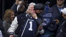 Toronto Mayor Rob Ford get a kiss from Argos player Adriano Belli during a Grey Cup celebration at Nathan Phillips Square Nov 27, 2012. (Moe Doiron/The Globe and Mail)