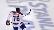 Montreal Canadiens defenseman P.K. Subban kicks the puck off his skate while warming up before facing the Boston Bruins in Game 5 of the second-round of the Stanley Cup hockey playoff series in Boston, Saturday, May 10, 2014. (Charles Krupa/AP)