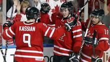 Canada's Ryan Johansen (C) celebrates his goal on the USA with teammates Zack Kassian (L) and Brayden Schenn during the second period of their semi-final game at the IIHF World Junior Hockey Championships in Buffalo, New York January 3, 2011. (BRENDAN MCDERMID)