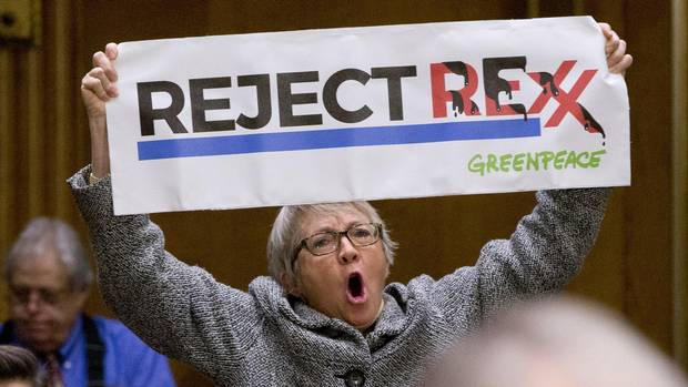 A protester yells during the confirmation hearing for Secretary of State-designate Rex Tillerson before the Senate Foreign Relations Committee, Wednesday, Jan. 11, 2017, on Capitol Hill in Washington.