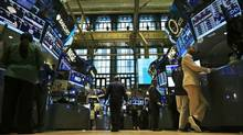 Traders work on the floor of the New York Stock Exchange Sept. 3, 2013. Gluskin Sheff says its assets under management grew 13 per cent despite volatility in global markets. (BRENDAN MCDERMID/REUTERS)
