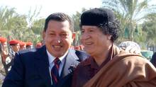 Libyan leader Moammar Ghadafi, right, greets Venezuelan President Hugo Chavez in Tripoli, Libya, Wednesday, Nov. 24, 2004. ( (Juan Carlos Solorzano/The Associated Press/Juan Carlos Solorzano/The Associated Press)